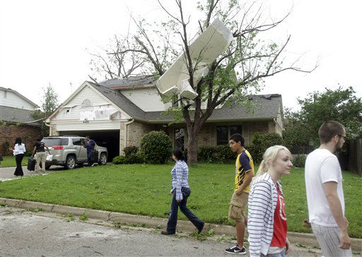 Neighbors walk along Oak Springs Drive as a family leaves their home in Arlington, Texas Tuesday, April 3, 2012. A violent storm spawning tornadoes has touched down in the Dallas-Fort Worth area. &#40;AP Photo&#47;Kim Johnson Flodin&#41; <span class=meta>(AP Photo&#47; Kim Johnson Flodin)</span>