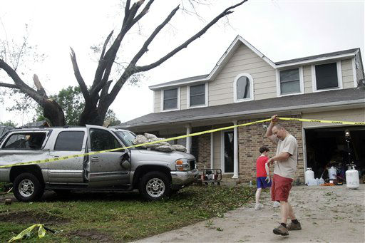 "<div class=""meta ""><span class=""caption-text "">Bill Brangers helps bring ice to his neighbors after a tornado damaged their home Tuesday, April 3, 2012 in Arlington, Texas. A violent storm spawning tornadoes has touched down in the Dallas-Fort Worth area. (AP Photo/Kim Johnson Flodin) (AP Photo/ Kim Johnson Flodin)</span></div>"