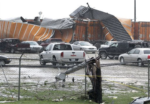 Tractor trailers sit toppled on each other with destroyed vehicles in a lot at the Kenworth trailer lot Tuesday, April 3, 2012, in Lancaster, Texas. Tornadoes tore through the Dallas area Tuesday, peeling roofs off homes, tossing big-rig trucks into the air and leaving flattened tractor trailers strewn along highways and parking lots. &#40;AP Photo&#47;Tony Gutierrez&#41; <span class=meta>(AP Photo&#47; Tony Gutierrez)</span>