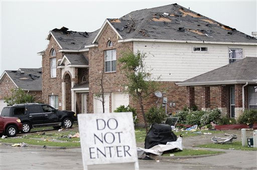 A damaged home is seen in the Diamond Creek subdivision after a tornado swept through the area Tuesday, April 3, 2012, in Forney, Texas. Tornadoes tore through the Dallas area Tuesday, peeling roofs off homes, tossing big-rig trucks into the air and leaving flattened tractor trailers strewn along highways and parking lots. &#40;AP Photo&#47;Tony Gutierrez&#41; <span class=meta>(AP Photo&#47; Tony Gutierrez)</span>