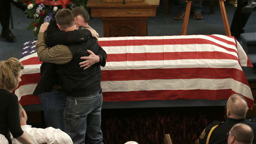 "<div class=""meta ""><span class=""caption-text "">Family of Kaufman County District Attorney Mike McLelland and his wife, Cynthia comfort each other during their funeral services at  the First Baptist Church of Wortham Friday, April 5, 2013, in Wortham, Texas.  The couple was found shot to death Saturday in their house near Forney, about 20 miles east of Dallas. No arrests have been made.  (AP Photo/ LM Otero)</span></div>"