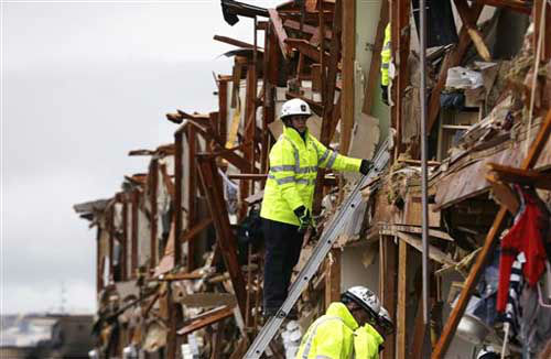 "<div class=""meta ""><span class=""caption-text "">Firefighters conduct a search and rescue of an apartment destroyed by an explosion at a fertilizer plant in West, Texas, Thursday, April 18, 2013.  A massive explosion at the plant killed as many as 15 people and injured more than 160, officials said overnight.   (Photo/LM Otero)</span></div>"