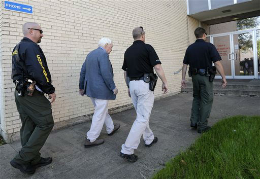 "<div class=""meta ""><span class=""caption-text "">Kaufman county law enforcement officials escort an employee inside the county courthouse Monday, April 1, 2013, in Kaufman, Texas.   Law enforcement officials throughout Texas remained on high alert Monday seeking to better protect prosecutors and their staffs following the killing of county district attorney whose assistant was gunned down just months ago. (AP Photo/Tony Gutierrez)  (AP Photo/ Tony Gutierrez)</span></div>"