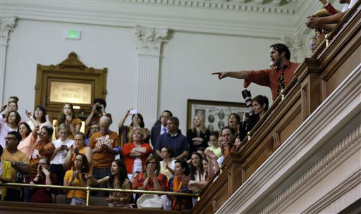 "<div class=""meta image-caption""><div class=""origin-logo origin-image ""><span></span></div><span class=""caption-text"">Members of the gallery cheer and chant as the Texas Senate tries to bring an abortion bill to a vote as time expires, Wednesday, June 26, 2013, in Austin, Texas. Amid the deafening roar of abortion rights supporters, Texas Republicans huddled around the Senate podium to pass new abortion restrictions, but whether the vote was cast before or after midnight is in dispute. If signed into law, the measures would close almost every abortion clinic in Texas.  (AP Photo/ Eric Gay)</span></div>"