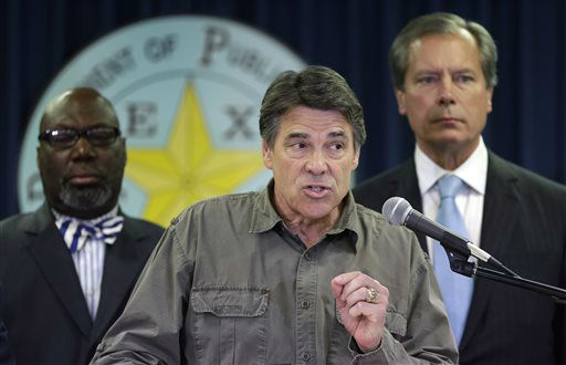 Gov. Rick Perry, center,  speaks during a news conference updating information about the state&#39;s emergency response to the explosion and fires in West, Texas, Thursday, April 18, 2013, in Austin, Texas.  A massive explosion at the West Fertilizer Co. killed as many as 15 people and injured more than 160, officials said overnight.  The explosion that struck around 8 p.m. Wednesday, sent flames shooting into the night sky and rained burning embers and debris down on shocked and frightened residents.     <span class=meta>(AP Photo&#47; Eric Gay)</span>
