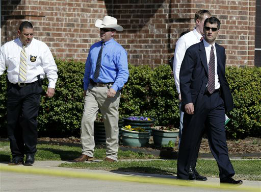 "<div class=""meta ""><span class=""caption-text "">Law enforcement officials walk out of the home of Kaufman District Attorney Mike McLelland Monday, April 1, 2013, near Forney, Texas. McLelland and his wife were murdered on Saturday at their home.  (AP Photo/ Tony Gutierrez)</span></div>"