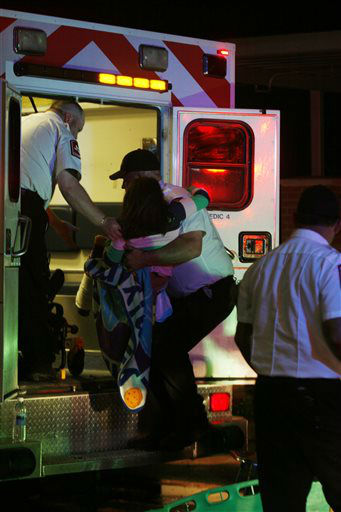 A young injured girl is put on an ambulance in Granbury, Texas, on Wednesday May 15, 2013.  A rash of tornadoes slammed into several small communities in North Texas overnight, leaving at least six people dead, dozens more injured and hundreds homeless. The violent spring storm scattered bodies, flattened homes and threw trailers onto cars.   <span class=meta>(AP Photo&#47; Mike Fuentes)</span>