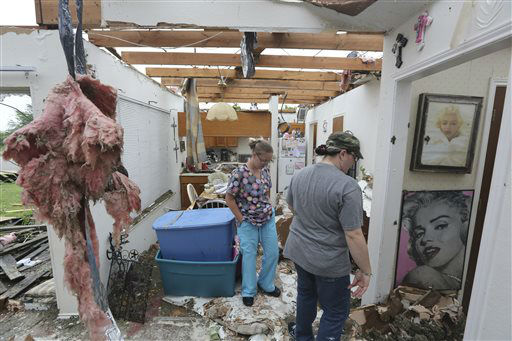 "<div class=""meta ""><span class=""caption-text "">People look at damage as they help to start cleaning up and salvage items from a home that was destroyed by a tornado in Cleburne, Texas, Thursday, May 16, 2013.  Ten tornadoes touched down in several small communities in Texas overnight, leaving at least six people dead, dozens injured and hundreds homeless. Emergency responders were still searching for missing people Thursday afternoon.   (AP Photo/ LM Otero)</span></div>"