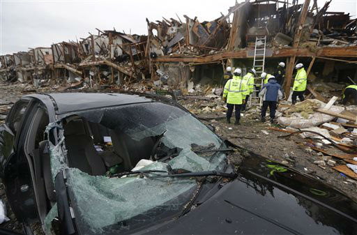A destroyed car sits as firefighters conduct a search and rescue of an apartment complex destroyed by an explosion at a fertilizer plant in West, Texas, Thursday, April 18, 2013.  A massive explosion at the West Fertilizer Co. killed as many as 15 people and injured more than 160, officials said overnight.    <span class=meta>(AP Photo&#47; LM Otero)</span>