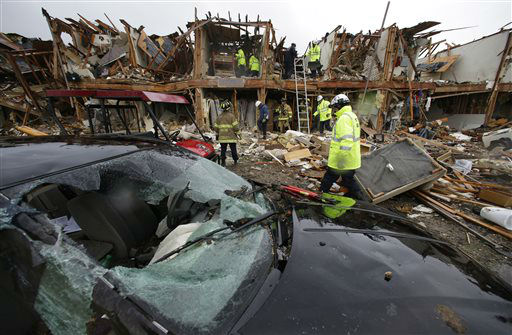A smashed car sits in front of an apartment complex destroyed by an explosion at a fertilizer plant in West, Texas, as firefighters conduct a search and rescue Thursday, April 18, 2013. A massive explosion at the West Fertilizer Co. Wednesday night killed as many as 15 people and injured more than 160, officials said overnight.   <span class=meta>(AP Photo&#47; LM Otero)</span>