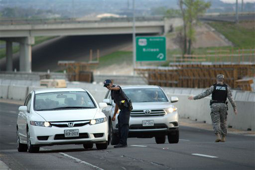 "<div class=""meta ""><span class=""caption-text "">Local and Military police direct traffic outside of an entrance to Fort Hood following reports of an active shooting on the military base in Wednesday, April 2, 2014, in Fort Hood, Texas.   (AP Photo/Tamir Kalifa)</span></div>"