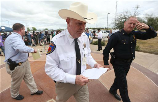 Kaufman County Sheriff David Byrnes, center, walks away after a news conference in Kaufman, Texas, on Sunday March 31, 2013. On Saturday, Kaufman County District Attorney Mike McLelland and his wife, Cynthia, were murdered in their home.  <span class=meta>(AP Photo&#47; Mike Fuentes)</span>