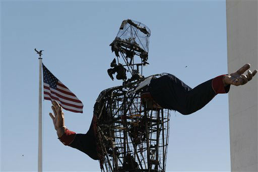 The burned remains of Big Tex stand at the State Fair of Texas Friday, Oct. 19, 2012, in Dallas. Fire destroyed Big Tex on Friday, leaving behind little more than the metal frame of the 52-foot-tall metal-and-fabric cowboy that is an icon of the State Fair of Texas.. <span class=meta>(AP Photo&#47;LM Otero)</span>
