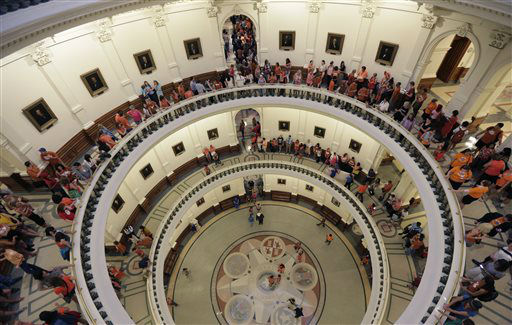 "<div class=""meta image-caption""><div class=""origin-logo origin-image ""><span></span></div><span class=""caption-text"">Hundreds line up to enter the Senate Chamber spills into multiple levels of the rotunda as Sen. Wendy Davis, D-Fort Worth, filibusters in an effort to kill an abortion bill, Tuesday, June 25, 2013, in Austin, Texas. The bill would ban abortion after 20 weeks of pregnancy and force many clinics that perform the procedure to upgrade their facilities and be classified as ambulatory surgical centers.   (AP Photo/ Eric Gay)</span></div>"