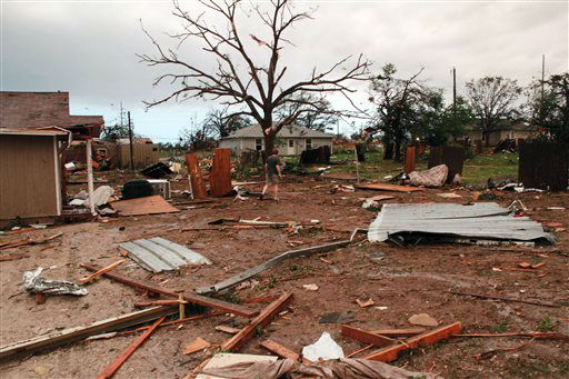 This May 16, 2013 photo provided by Nichole Tomlin shows her Granbury, Texas backyard and rubble where Tomlin says there used to be a neighborhood. A rash of tornadoes slammed into several small communities in North Texas overnight, leaving at least six people dead, dozens more injured and hundreds homeless. The violent spring storm scattered bodies, flattened homes and threw trailers onto cars. <span class=meta>(AP Photo&#47; Nichole Tomlin)</span>