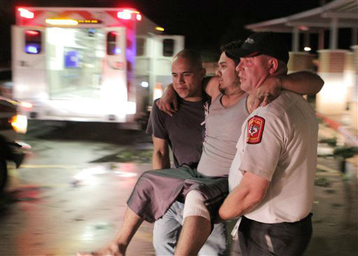 Johnny Ortiz, left, and James South, right, carry Miguel Morales, center, who was injured in a tornado, to an ambulance in Granbury, Texas, on Wednesday May 15, 2013. Officials report the tornado caused &#34;multiple fatalities&#34; as it tore through two neighborhoods of a North Texas town. Hood County sheriff&#39;s Lt. Kathy Jiveden reported the multiple fatalities, but she had no estimate of dead or injured.   <span class=meta>(AP Photo&#47; Mike Fuentes)</span>