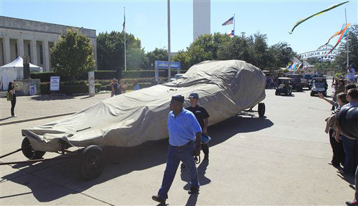 The covered remains of Big Tex are rolled away at the State Fair of Texas, Friday, Oct. 19, 2012, in Dallas. The iconic structure was destroyed Friday when flames engulfed his 52-foot-tall frame. &#40;AP Photo&#47;LM Otero&#41; <span class=meta>(AP Photo&#47; LM Otero)</span>
