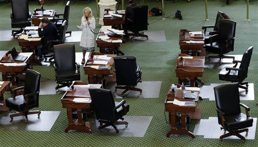 "<div class=""meta image-caption""><div class=""origin-logo origin-image ""><span></span></div><span class=""caption-text"">Sen. Wendy Davis, D-Fort Worth, stands on a near empty senate floor as she filibusters in an effort to kill an abortion bill, Tuesday, June 25, 2013, in Austin, Texas. The bill would ban abortion after 20 weeks of pregnancy and force many clinics that perform the procedure to upgrade their facilities and be classified as ambulatory surgical centers.    (AP Photo/ Eric Gay)</span></div>"