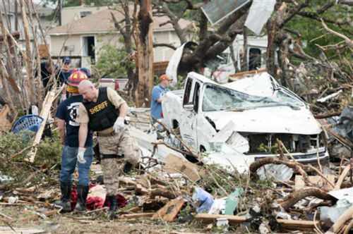 Emergency personnel look through the tornado debris on near Granbury, Texas. on Thursday, May 16, 2013.  Six people were killed in the storm that struck the night before.   <span class=meta>(AP Photo&#47; Rex C. Curry)</span>