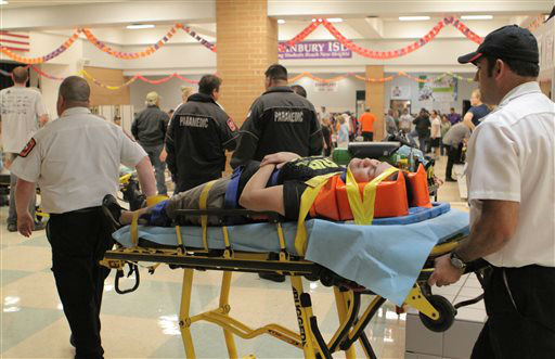 An unidentified injured person is carried to an ambulance in Granbury, Texas, on Wednesday May 15, 2013. Officials report the tornado caused &#34;multiple fatalities&#34; as it tore through two neighborhoods of a North Texas town. Hood County sheriff&#39;s Lt. Kathy Jiveden reported the multiple fatalities, but she had no estimate of dead or injured.   <span class=meta>(AP Photo&#47; Mike Fuentes)</span>