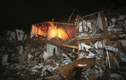 A fire still burns in a apartment complex destroyed near a fertilizer plant that exploded earlier in West, Texas, in this photo made early Thursday morning, April 18, 2013.    <span class=meta>(AP Photo&#47; LM Otero)</span>