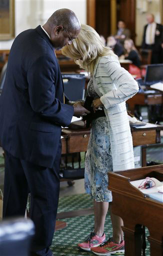 "<div class=""meta image-caption""><div class=""origin-logo origin-image ""><span></span></div><span class=""caption-text"">Sen. Rodney Ellis, D-Houston, left, helps Sen. Wendy Davis, D-Fort Worth, right, with a back brace during her filibusters of an abortion bill, Tuesday, June 25, 2013, in Austin, Texas. Davis was given a second warning for breaking filibuster rules.   (AP Photo/ Eric Gay)</span></div>"