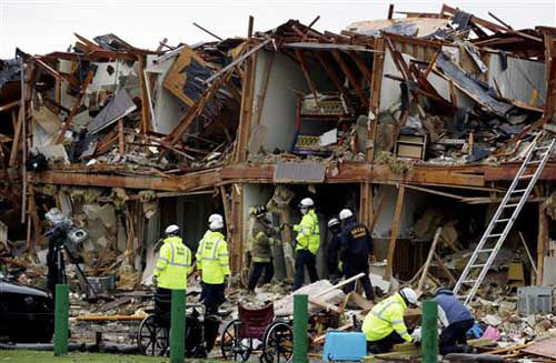 "<div class=""meta ""><span class=""caption-text "">Firefighters conduct a search and rescue of an apartment destroyed by an explosion at a fertilizer plant in West, Texas, Thursday, April 18, 2013.  A massive explosion at the West Fertilizer Co. killed as many as 15 people and injured more than 160, officials said overnight.   (Photo/LM Otero)</span></div>"