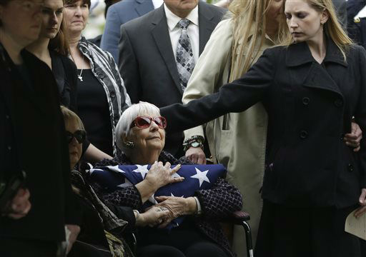 "<div class=""meta ""><span class=""caption-text "">Shirley Woodward, mother of Cynthia McLelland holds a flag and is comforted by family after memorial services for her daughter and son-in-law Kaufman County District Attorney Mike McLelland after a memorial services in Mesquite, Texas, Thursday, April 4, 2013.  The Kaufman County District Attorney Mike McLelland and his wife, Cynthia, were found shot to death Saturday in their house near Forney, about 20 miles east of Dallas. No arrests have been made.   (AP Photo/ LM Otero)</span></div>"