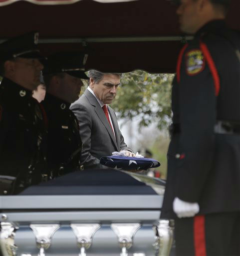 Texas Gov. Rick Perry takes a flag to present to the family of Kaufman County District Attorney Mike McLelland and his wife, Cynthia after a memorial services in Mesquite, Texas, Thursday, April 4, 2013.  The Kaufman County District Attorney Mike McLelland and his wife, Cynthia, were found shot to death Saturday in their house near Forney, about 20 miles east of Dallas. No arrests have been made.   <span class=meta>(AP Photo&#47; LM Otero)</span>