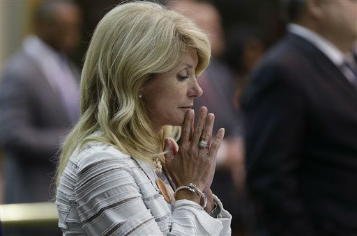 "<div class=""meta image-caption""><div class=""origin-logo origin-image ""><span></span></div><span class=""caption-text"">Sen. Wendy Davis, D-Fort Worth, reacts after she was called for a third and final violation in rules to end her filibuster attempt to kill an abortion bill, Tuesday, June 25, 2013, in Austin, Texas. The bill would ban abortion after 20 weeks of pregnancy and force many clinics that perform the procedure to upgrade their facilities and be classified as ambulatory surgical centers.   (AP Photo/ Eric Gay)</span></div>"