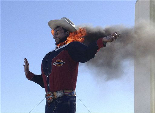 "<div class=""meta ""><span class=""caption-text "">Fire begins to engulf the Big Tex displayed at the State Fair of Texas in Dallas Friday, Oct. 19, 2012. The iconic structure was destroyed Friday when flames engulfed his 52-foot-tall frame. (AP Photo/John McKibben) (AP Photo/ John McKibben)</span></div>"