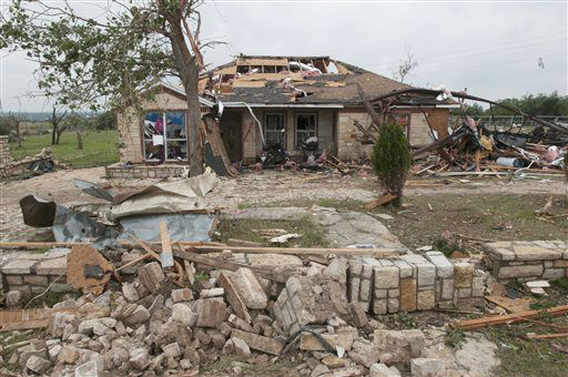 A house damaged by a tornado that passed through the area on Wednesday near Granbury, Texas on Thursday, May 16, 2013.  Ten tornadoes touched down in several small communities in Texas overnight, leaving at least six people dead, dozens injured and hundreds homeless. Emergency responders were still searching for missing people Thursday afternoon.   <span class=meta>(AP Photo&#47; Rex C. Curry)</span>