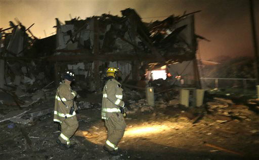 Firefighters walk next to a destroyed apartment complex near a fertilizer plant that exploded earlier in West, Texas, in this photo made early Thursday morning, April 18, 2013.   <span class=meta>(AP Photo&#47; LM Otero)</span>