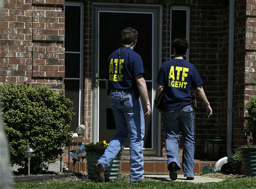 "<div class=""meta ""><span class=""caption-text "">ATF agents walk into the home of Kaufman District Attorney Mike McLelland Monday, April 1, 2013, near Forney, Texas. McLelland and his wife were murdered on Saturday at their home.  (AP Photo/ Tony Gutierrez)</span></div>"
