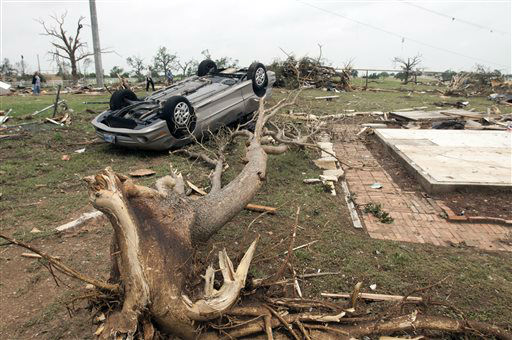 "<div class=""meta ""><span class=""caption-text "">A car is turned upside down after a tornado passed through the area Wednesday near near Granbury, Texas on Thursday, May 16, 2013.  Ten tornadoes touched down in several small communities in Texas overnight, leaving at least six people dead, dozens injured and hundreds homeless. Emergency responders were still searching for missing people Thursday afternoon.   (AP Photo/ Rex C. Curry)</span></div>"