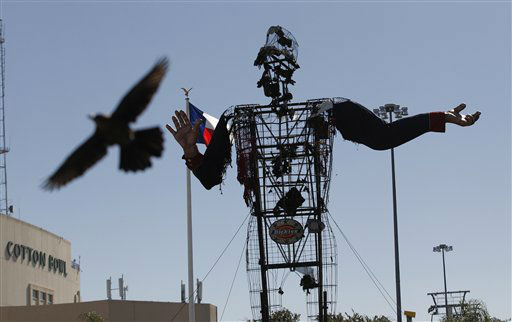 "<div class=""meta ""><span class=""caption-text "">The burned remains of Big Tex stand at the State Fair of Texas  Friday, Oct. 19, 2012, in Dallas. The iconic structure was destroyed Friday when flames engulfed his 52-foot-tall frame. (AP Photo/LM Otero) (AP Photo/ LM Otero)</span></div>"