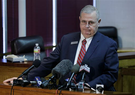 "<div class=""meta ""><span class=""caption-text "">Kaufman county judge Bruce Wood pauses as he responds to a reporters question during a news conference at the county court house annex Monday, April 1, 2013, in Kaufman, Texas. Law enforcement officials throughout Texas remained on high alert Monday seeking to better protect prosecutors and their staffs following the killing of county district attorney whose assistant was gunned down just months ago.  (AP Photo/ Tony Gutierrez)</span></div>"