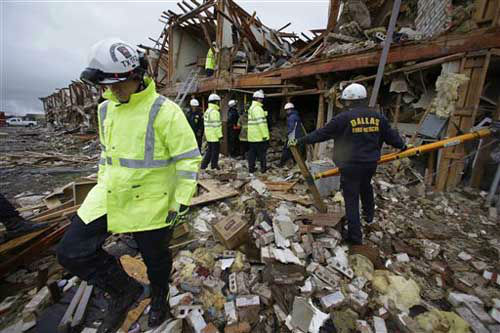 "<div class=""meta ""><span class=""caption-text "">Firefighters conduct a search and rescue of an apartment building destroyed Wednesday by an explosion at a fertilizer plant in West, Texas, Thursday, April 18, 2013. The massive explosion at the plant killed as many as 15 people and injured more than 160, officials said overnight.   (Photo/LM Otero)</span></div>"
