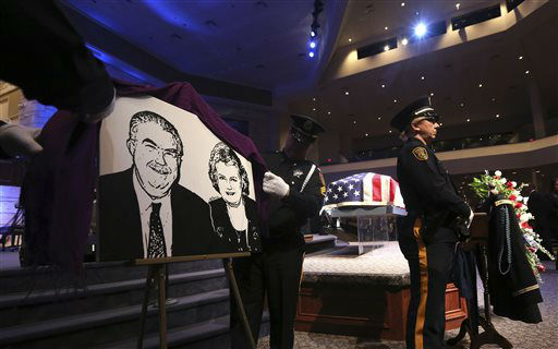 An image of Kaufman County District Attorney Mike McLelland and his wife, Cynthia is unveiled before a memorial services in Mesquite, Texas, Thursday, April 4, 2013.  The Kaufman County District Attorney Mike McLelland and his wife, Cynthia, were found shot to death Saturday in their house near Forney, about 20 miles east of Dallas. No arrests have been made.   <span class=meta>(AP Photo&#47; LM Otero)</span>