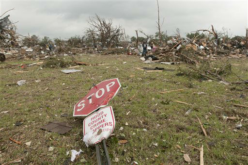 A stop sign was knocked to the ground after a tornado passed through the area in Granbury, Texas  on Thursday, May 16, 2013.  Ten tornadoes touched down in several small communities in Texas overnight, leaving at least six people dead, dozens injured and hundreds homeless. Emergency responders were still searching for missing people Thursday afternoon.  <span class=meta>(AP Photo&#47; Rex C. Curry)</span>