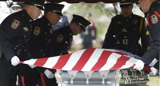 "<div class=""meta ""><span class=""caption-text "">An honor guard picks up the flag on the remains of Kaufman County District Attorney Mike McLelland and his wife, Cynthia after a memorial services in Mesquite, Texas, Thursday, April 4, 2013.  The Kaufman County District Attorney Mike McLelland and his wife, Cynthia, were found shot to death Saturday in their house near Forney, about 20 miles east of Dallas. No arrests have been made.   (AP Photo/ LM Otero)</span></div>"