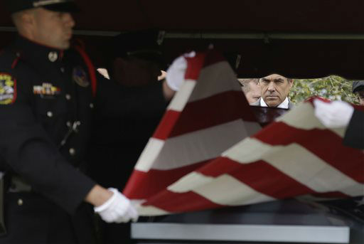 "<div class=""meta ""><span class=""caption-text "">Texas Gov. Rick Perry looks on as a flag is folded to present to the family of Kaufman County District Attorney Mike McLelland and his wife, Cynthia after a memorial services in Mesquite, Texas, Thursday, April 4, 2013.  The Kaufman County District Attorney Mike McLelland and his wife, Cynthia, were found shot to death Saturday in their house near Forney, about 20 miles east of Dallas. No arrests have been made.  (AP Photo/ LM Otero)</span></div>"