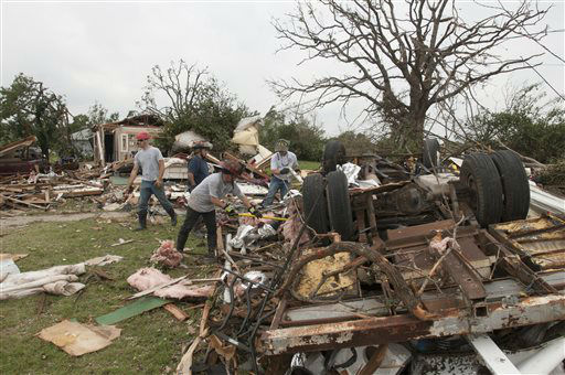 Firemen remove debris near Granbury, Texas on Thursday, May 16, 2013. Ten tornadoes touched down in several small communities in Texas overnight, leaving at least six people dead, dozens injured and hundreds homeless. Emergency responders were still searching for missing people Thursday afternoon.   <span class=meta>(AP Photo&#47; Rex C. Curry)</span>