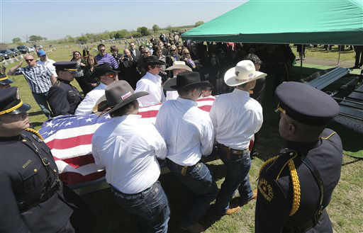 "<div class=""meta ""><span class=""caption-text "">Pallbearers carry the remains of Kaufman County District Attorney Mike McLelland and his wife Cynthia for burial in Wortham, Texas, Friday, April 5, 2013.  The couple was found shot to death Saturday in their house near Forney, about 20 miles east of Dallas. No arrests have been made.  (AP Photo/ LM Otero)</span></div>"