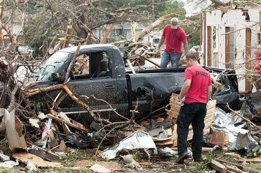A search team looks through debris near Granbury, Texas on Thursday, May 16, 2013.  Ten tornadoes touched down in several small communities in Texas overnight, leaving at least six people dead, dozens injured and hundreds homeless. Emergency responders were still searching for missing people Thursday afternoon.  <span class=meta>(AP Photo&#47; Rex C. Curry)</span>
