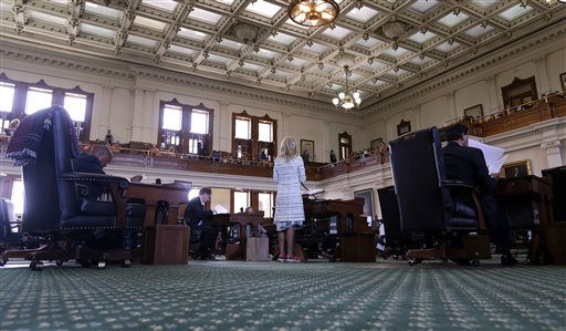 "<div class=""meta image-caption""><div class=""origin-logo origin-image ""><span></span></div><span class=""caption-text"">Sen. Wendy Davis, D-Fort Worth, center, speaks as she begins a filibusters in an effort to kill an abortion bill, Tuesday, June 25, 2013, in Austin, Texas. The bill would ban abortion after 20 weeks of pregnancy and force many clinics that perform the procedure to upgrade their facilities and be classified as ambulatory surgical centers.   (AP Photo/ Eric Gay)</span></div>"