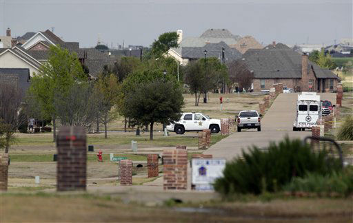 "<div class=""meta ""><span class=""caption-text "">Kaufman County officials investigate a residential crime scene in Forney, Texas, on Sunday, March 31, 2013. On Saturday, Kaufman County District Attorney Mike McLelland and his wife, Cynthia, were murdered in their home.  (AP Photo/ Mike Fuentes)</span></div>"