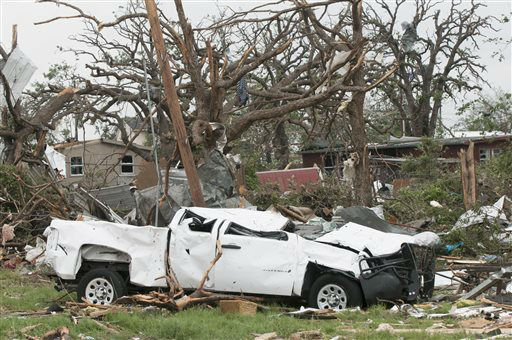 The cab of a pickup truck flattened by a tornado is surrounded by debris near Granbury, Texas on Thursday, May 16, 2013.  Ten tornadoes touched down in several small communities in Texas overnight, leaving at least six people dead, dozens injured and hundreds homeless. Emergency responders were still searching for missing people Thursday afternoon.   <span class=meta>(AP Photo&#47; Rex C. Curry)</span>