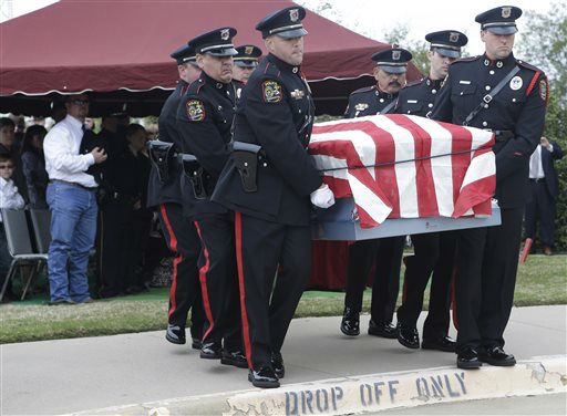 An honor guard moves the remains of Kaufman County District Attorney Mike McLelland and his wife, Cynthia after a memorial services in Mesquite, Texas, Thursday, April 4, 2013.  The Kaufman County District Attorney Mike McLelland and his wife, Cynthia, were found shot to death Saturday in their house near Forney, about 20 miles east of Dallas. No arrests have been made.   <span class=meta>(AP Photo&#47; LM Otero)</span>
