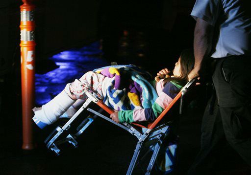 An unidentified injured young girl is wheeled to an awaiting ambulance in Granbury, Texas, on Wednesday May 15, 2013. Granby was the worst hit city as a rash of tornadoes slammed into several small communities in North Texas overnight, leaving at least six people dead, dozens more injured and hundreds homeless.    <span class=meta>(AP Photo&#47; Mike Fuentes)</span>